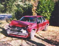 Photograph of a Wrecked Car